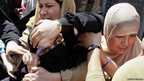 Indian policewomen detain a member of Dukhtaran-e-Milat