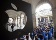 Apple Store employees create a tunnel for customers as they are allowed into the shop to buy the new iPhone 5 smart phone.