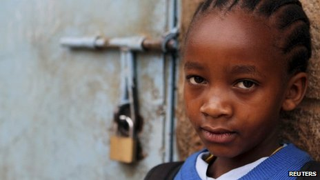 A girl stands next to her locked classroom in Nairobi, Kenya - 5 September 2012