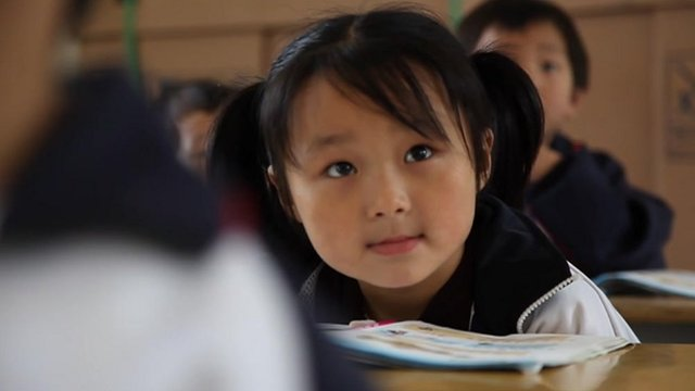 A Chinese classroom, where there are only two girls amongst twelve students