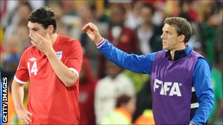 Stephen Warnock (r) consoles Gareth Barry after England's World Cup defeat to Germany in 2010