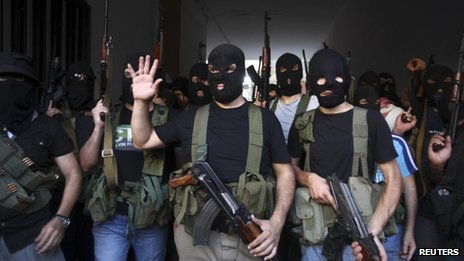 Masked gunmen from the Mekdad clan