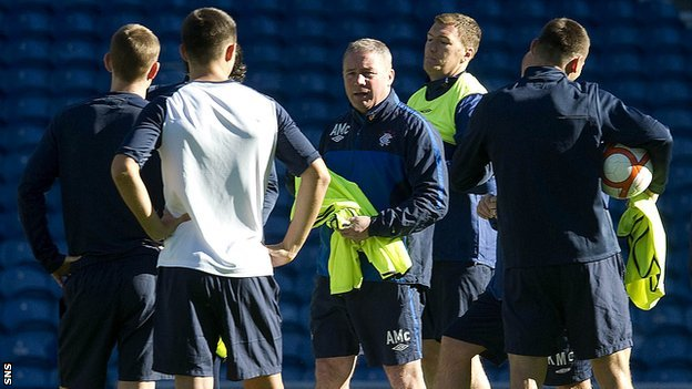 Ally McCoist oversees Rangers players in training