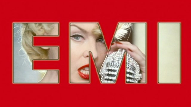 Kylie Minogue under an EMI graphic