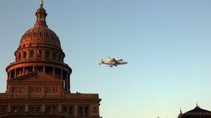 Endeavour flies past the Texas state Capitol in Austin 20 September 2012