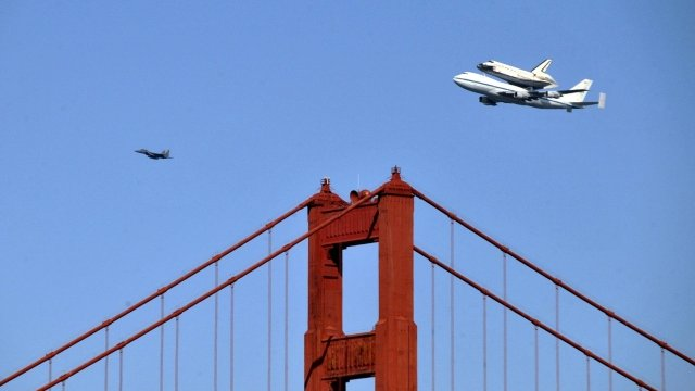 Nasa's shuttle Endeavour flying piggy-back on a Boeing 747 over the Golden Gate Bridge in San Francisco