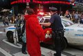 A man, dressed as the Muppet character Elmo, is arrested in New York's Times Square.