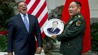 Leon Panetta is presented with a plate from General Liang Guang Lie