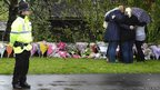 Women lay floral tributes close to where police constables Fiona Bone and Nicola Hughes were killed