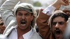 Protesters shout slogans in Sanaa, Yemen, 21 September