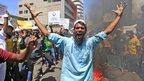 Muslim protesters burn an effigy of US President Barack Obama in Colombo, Sri Lanka, 21 September