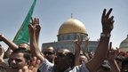 Palestinians demonstrate outside the Dome of the Rock at the al-Aqsa mosque compound in Jerusalem's Old City, 21 September