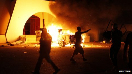 Protesters set light to buildings and a car at the Ansar al-Sharia base