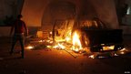 Car burns at headquarters of Islamist Ansar al-Sharia militia in Benghazi. 21 Sept 2012