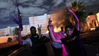 Protesters celebrate as headquarters of Ansar al-Sharia burn in Benghazi. 21 Sept 2012