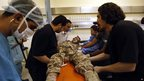 Doctors at Benghazi Medical Centre help a wounded Libyan soldier. 21 Sept 2012