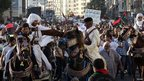 Protesters chant against armed militias during a march in Benghazi. 21 Sept 2012