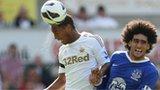Swansea's Jonathan de Guzman beats Everton's Marouane Fellaini