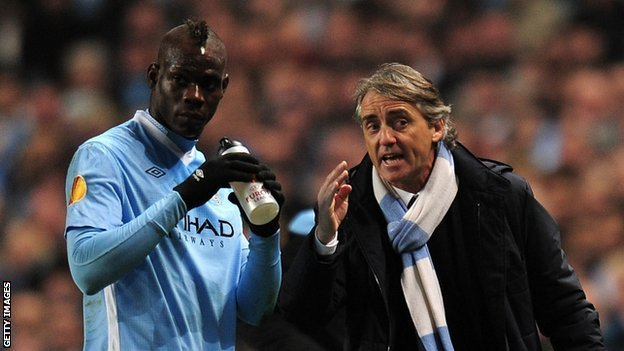 Mario Balotelli (left) and Roberto Mancini (right)