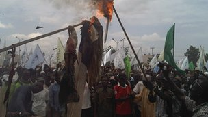 Demonstrators burn flags in Kano