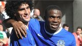 Everton scorers Marouane Fellaini and Victor Anichebe celebrate at the Liberty Stadium
