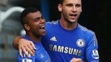 Chelsea defender Ashley Cole celebrates with Branislav Ivanovic