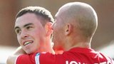 Joby Lynch celebrates with Cliftonville team-mate Barry Johnston