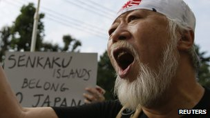 A man shouts slogans at an anti-Chinese rally in Tokyo, 22 September