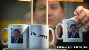 "Mugs depicting Nick Clegg with the words ""I'm Sorry"" at the Liberal Democrat conference in Brighton"