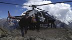 Rescuers carry out a victim from the avalanche on Mount Manaslu, 23 September