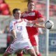 Portadown's Kevin Braniff attempts to shield the ball from Cliftonville opponent Marc Smith at Solitude