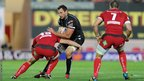 Joe Bearman is halted by Jonathan Davies