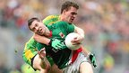 Donegal defender Eamon McGee ensures there is no way past for Enda Varley