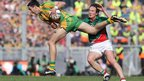 Rory Kavanagh charges past Mayo's Alan Dillon to launch a Donegal attack