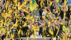 It's celebration time for Donegal fans as Michael Murphy has a bit of fun with the Sam Maguire Cup