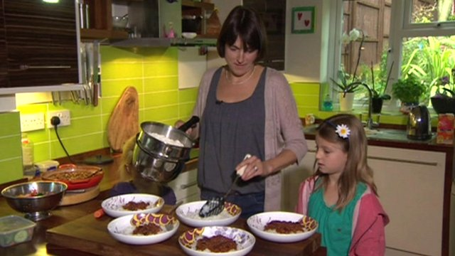 Natasha Hobbs and her daughter preparing food