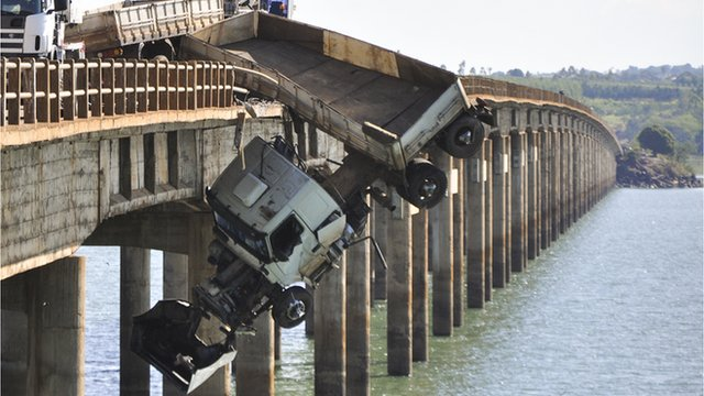 Truck stuck on side of bridge