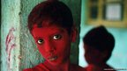 Steve McCurry took this picture of a boy during Holi, the festival of colours in the city of Mumbai (then Bombay) in 1996.