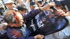 South Korean protesters struggle with riot police during an anti-Japanese rally
