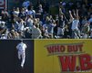 New York Yankees fielder Raul Ibanez climbs a wall in an attempt to reach a baseball