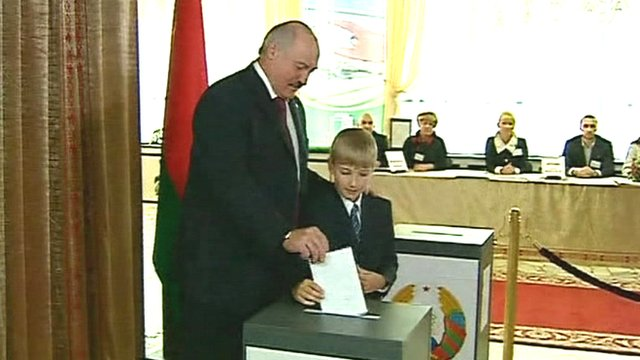 President Alexander Lukashenko casting his vote with his youngest son Nikolai