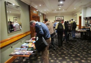 Delegates at Bufora conference look at books