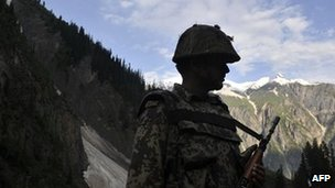 Indian soldier patrols the Kashmir border