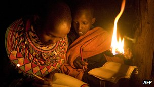 Children reading with naked light