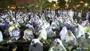 Thousands of opposition supporters protest outside parliament in Kuwait City (24 September 2012)