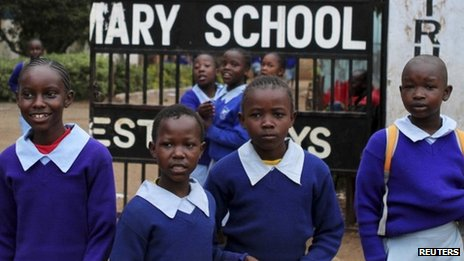 Children stand outside their primary school in Nairobi - 5 September 2012