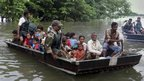 Indian army soldiers rescue flood victims in Sonitpur district of Assam state, India.