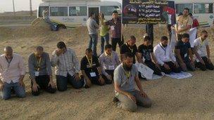 Abubakr holding prayers near Israeli border