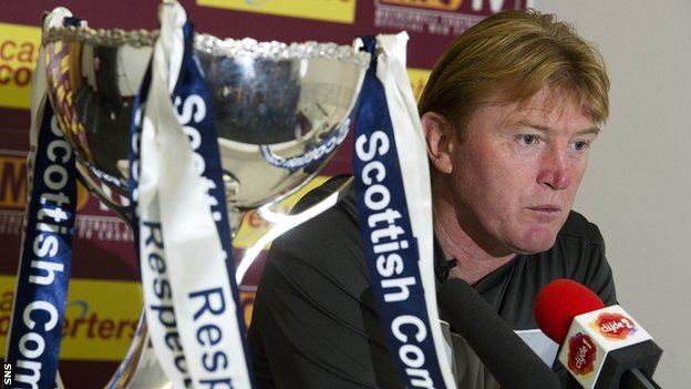 Motherwell manager Stuart McCall addresses the media