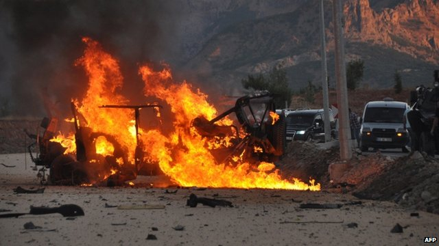 A vehicle burns after explosion in Tunceli